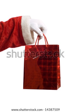 Father Christmas hand holding a red present on white - stock photo