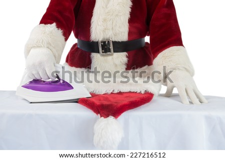 Father Christmas is ironing his hat on white background