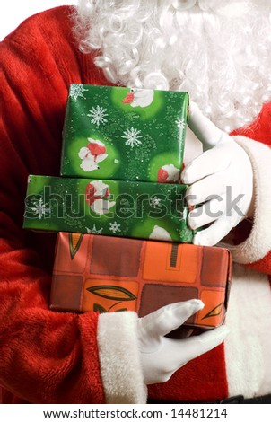 Father Christmas with wrapped boxes of presents in arms - stock photo