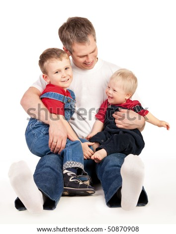 Father embrace his children - stock photo