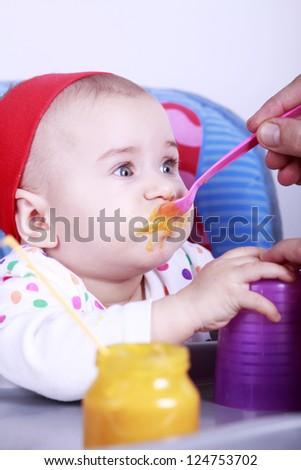 Father feeding baby - stock photo