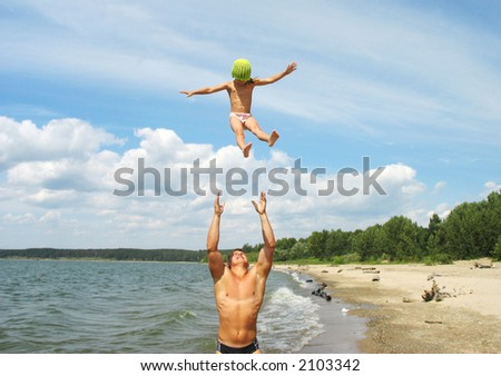 Father flips his daughter - stock photo