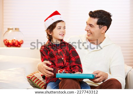 Father giving his son a gift at christmas eve - stock photo