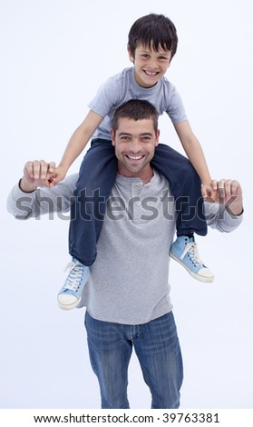 Father giving son piggyback ride at home - stock photo