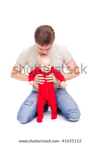 Father happy to play with his baby son, isolated - stock photo