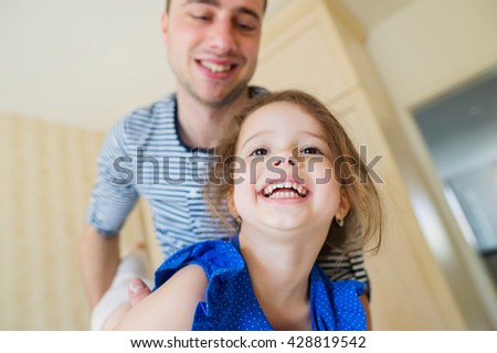 Father having fun with his cute little daughter