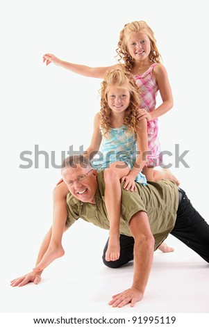 Father having fun with his twin daughters - stock photo