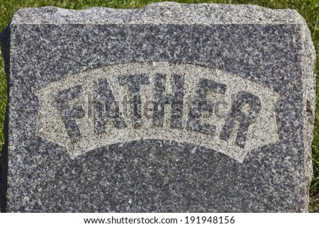 Father Headstone - Granite Cemetery Grave Headstone Marked with Father - stock photo