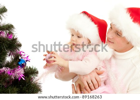Father helps daughter decorate Christmas tree - stock photo