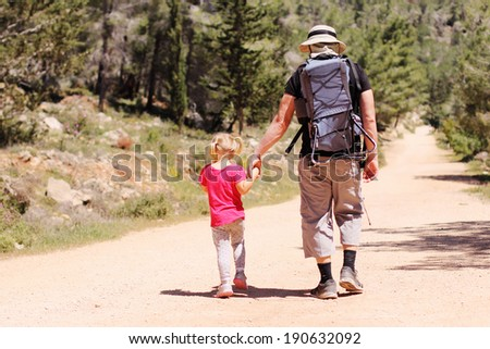 Father hiking with kid - stock photo