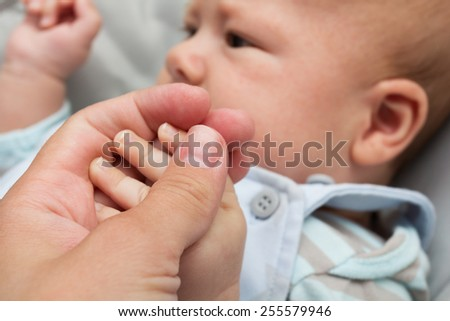 Father holding baby's hand
