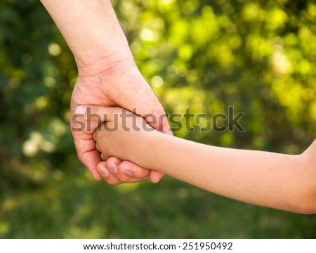 father holding  daughter hand - stock photo