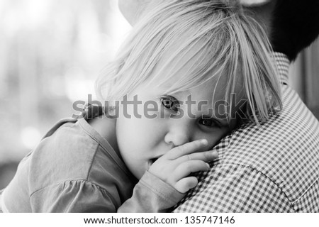 father holding his cute little daughter - stock photo