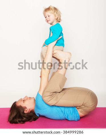 father holding his little son on his feet, yoga, happy family  - stock photo