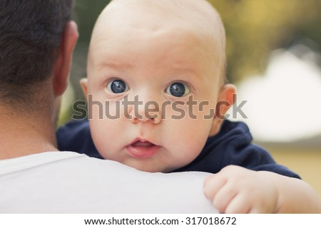Father holding his newborn baby boy. - stock photo