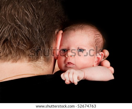 Father holding his twenty days old newborn baby - stock photo