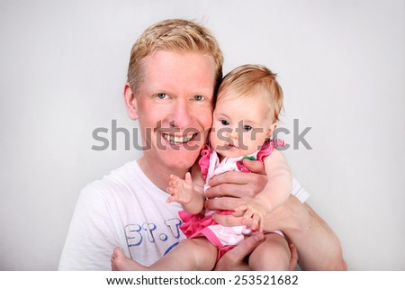 Father holding sweet baby girl - stock photo