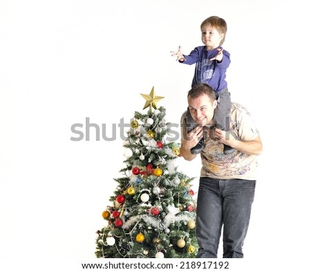 Father holds the son in one neck about a Christmas tree - stock photo