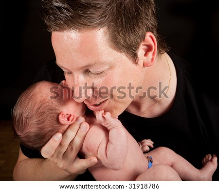 Father hugging his twenty days old newborn baby - stock photo