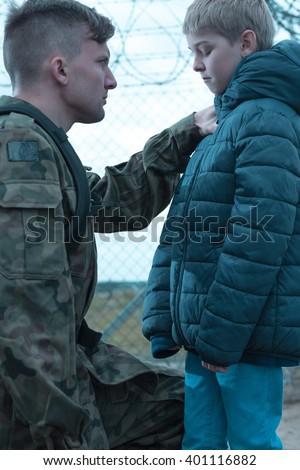 Father is saying goodbye to his son - stock photo
