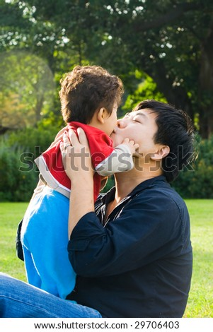 father kissing his baby boy - stock photo