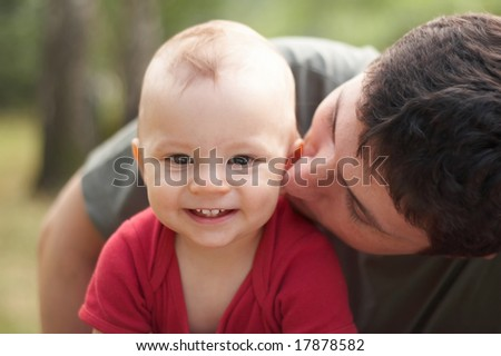 father kissing his son - stock photo