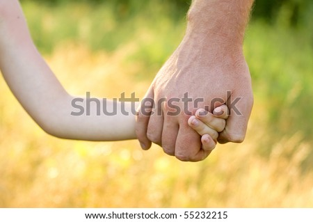 father lead by the hand son outdoor - stock photo