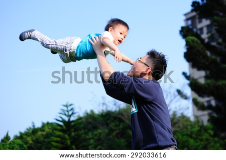 father lift his baby