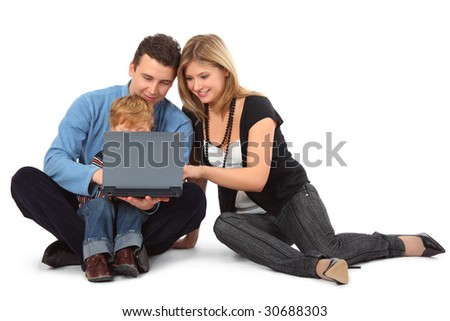 Father, mother and child look on laptop, full body - stock photo