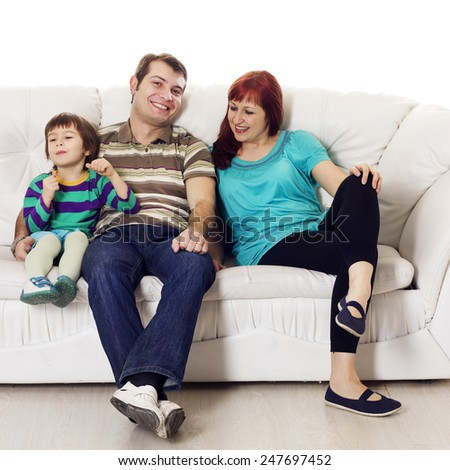 Father, mother and son sitting on the sofa over white background