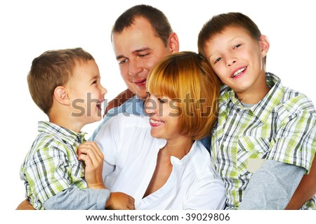 father, mother and their two sons laughing - stock photo