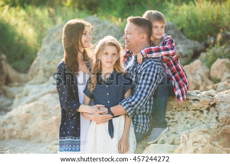 Father mother daughter and son. A happy family. - stock photo