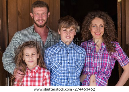 father mother daughter and son closeup family of four portrait focus on children - stock photo
