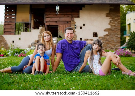 father, mother, son and daughter in the garden. sports family - stock photo