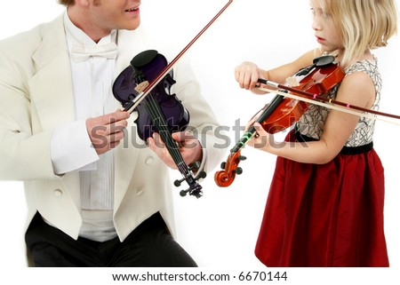 Father or teacher and five year old daughter in formal wear with violins - stock photo