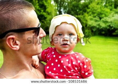 Father play's with his baby girl - stock photo