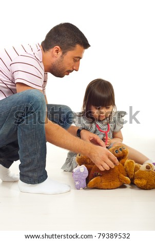 Father playing doctor with his daughter isolated on white background