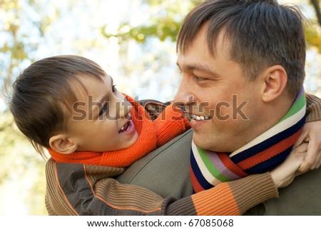 father playing with  child on nature