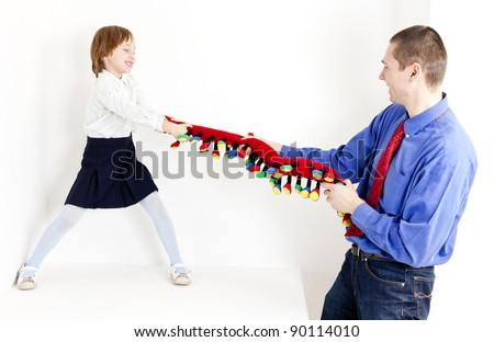 father playing with his daughter - stock photo