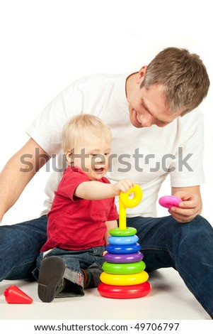 Father playing with his little son with pyramidion - stock photo