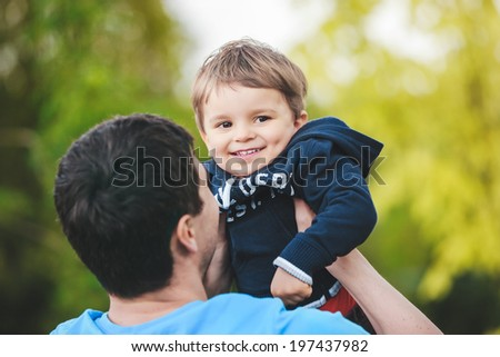father playing with his son, focus on the son - stock photo