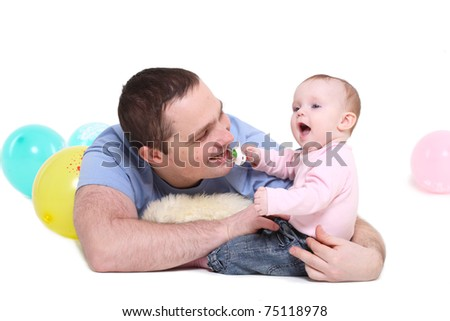 father plays with the eight-monthly daughter. It is isolated on a white background.