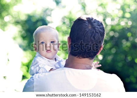 Father plays with the son in park
