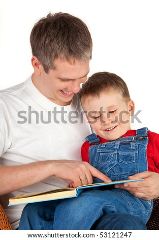 Father reading book his son - stock photo