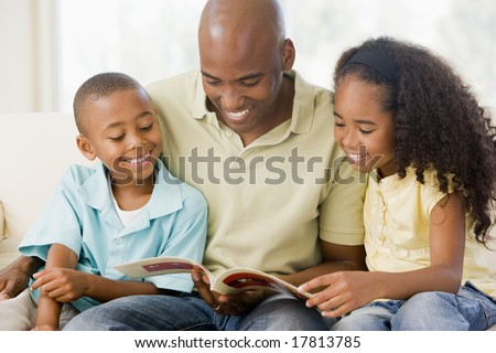 Father reading children a story - stock photo