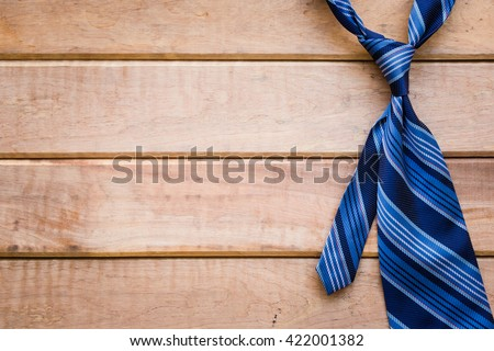Father's day background with blue necktie on rustic wooden background - stock photo