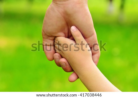 Father's Day. Dad holding son by the hand. Dad and son. Dad walking with son - stock photo