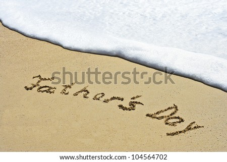 Father`s Day hand written in the sandy beach - stock photo