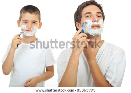 Father shaving in the mirror and the son imitate father in background - stock photo