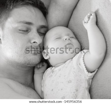 Father sleep with his baby. - stock photo